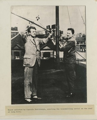 John Logie Baird assisted by Captain Hutchison, erecting the transmitting aerial on the roof at Long Acre, London, 1926.
