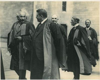 Einstein in the quadrangle after his Honorary graduation in 1933. Pictured with the Rt.Hon. Sir Robert Stevenson Horne, Heriot, and Harry Lumsden.