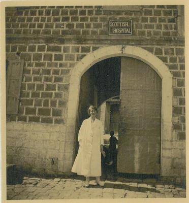 Dr Lydia Torrance at gate of Tiberias Hospital 1926