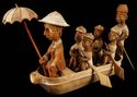 Woodcarving of colonial boat tour
